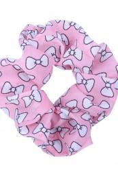 lyserød scrunchies med hvide sløjfer