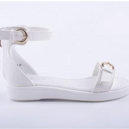 Sandal i hvid pu med spænder i guldlook.
