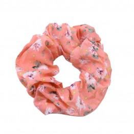 Image of   scrunchie i coral med blomster print.