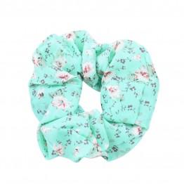 Image of   scrunchie i mintgrøn med blomster motiv.