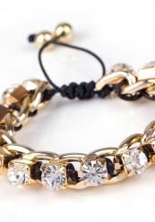 Sort flet armbånd med guld pynt og sten