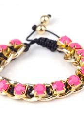 Sort flet armbånd med guld pynt og pink sten